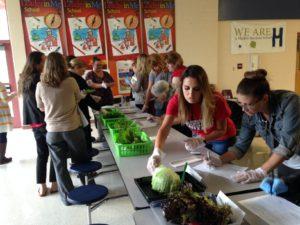 Teachers conduct taste testing of lettuce